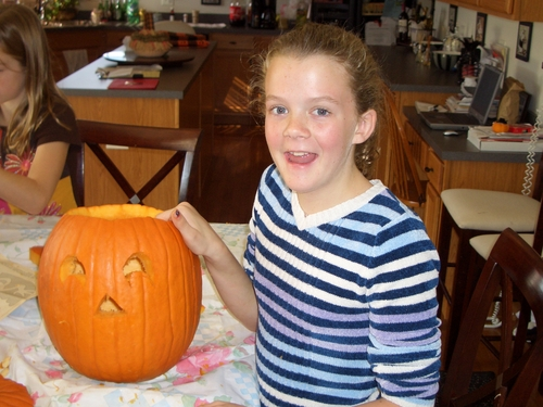 Bree carving a pumpkin (new).JPG