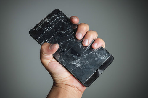 bigstock-Cracked-Smartphone-Screen-On-H-87325508.jpg