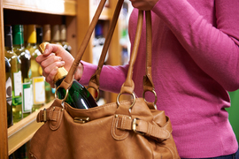 bigstock-Woman-Stealing-Bottle-Of-Wine--110281502.jpg